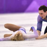 Germany's Aljona Savchenko and Bruno Massot react after competing in the pair free skating of the figure skating event at the Gangneung Ice Arena. | AFP-JIJI