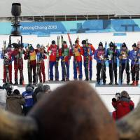 Following the men's 4x10 km cross-country relay, gold medallists Didirk Toenseth, Johnsrud Martin Sundby, Simen Hegstad Kreuger and Johannes Hoesflot Klaebo of Norway pose on the podium between silver medallists Andrey Larkov, Alexander Bolshunov, Alexey Chervotkin and Denis Spitsov, Olympic athletes from Russia, and bronze medallists Jean Marc Gaillard, Maurice Manificat, Clement Parisse and Adrien Backsheider of France | REUTERS