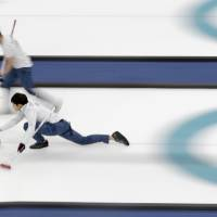 Japan's skip, Yusuke Morozumi, throws a stone during a men's curling match against United States. | AP