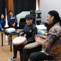 Drum class: Musician Gen Nagahara demonstrates an African djembe percussion for fifth- and sixth-graders at Toyotama Minami Elementary School. | KYODO