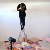 Kiina Matsunaga poses for a photo to add to her portfolio (an example of which can be seen right) at Moffy Photo Studio in Osaka.   J.J. O'DONOGHUE