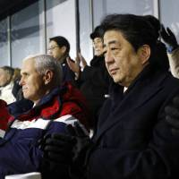Prime Minister Shinzo Abe watches the Feb. 9 opening ceremony of the 2018 Winter Olympics in Pyeongchang, South Korea, alongside U.S. Vice President Mike Pence and his wife, Karen. | AP