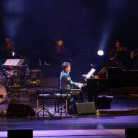 Piano man: Kunihiko Ryo plays piano at the 'Echoes for Pyeongchang' concert at Gangneung Art Center in Gangneung, South Korea, on Feb. 17. The musician says that finding a message of peace was foremost in his mind when planning the music for the opening and closing ceremonies at the current Winter Olympics.   COURESTY OF ENDORF MUSIC / VIA KYODO