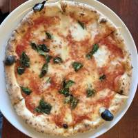 Echi Ponte Vecchio a Osaka's margherita pizza lives up to its gold standard reputation. | J. J. O'DONOGHUE
