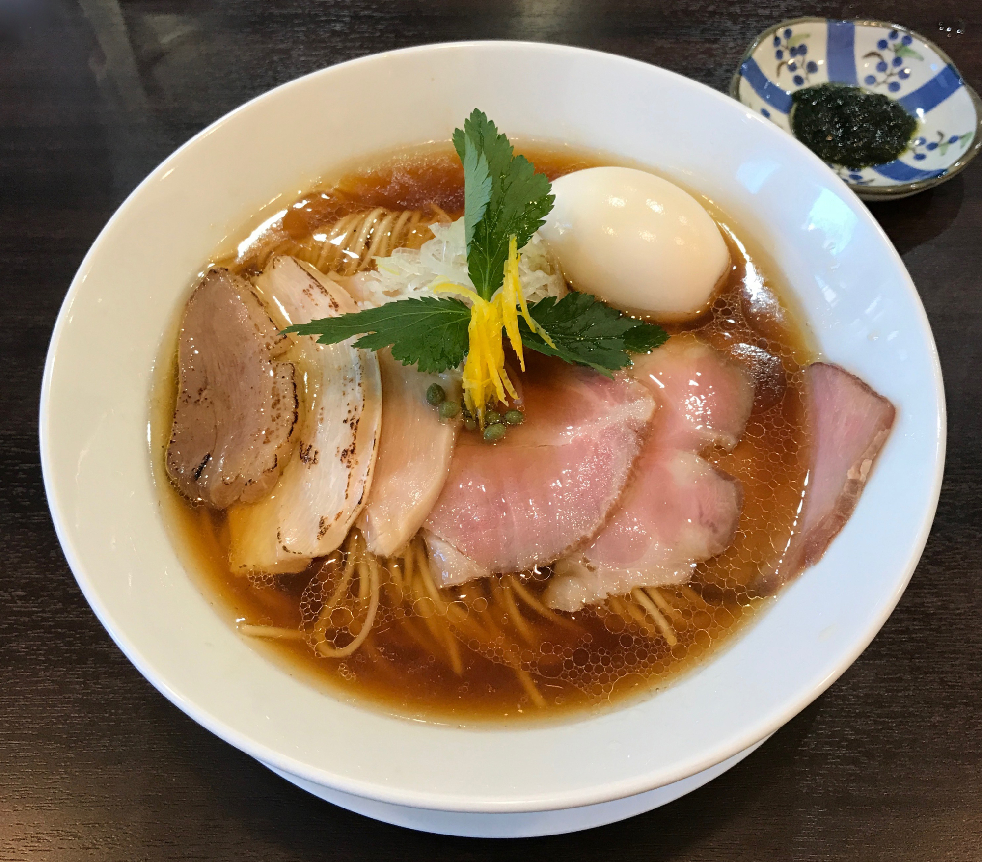 Triple crown: At Men Labo Hiro, the noodles come topped with slices of pork, chicken and duck. | ROBBIE SWINNERTON