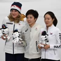 White knight: Gold medallist Nao Kodaira holds an Olympic mascot while posing for a photo with South Korea's Lee Sang-hwa and Czech Republic's Karolina Erbanova after the women's 500-meter speed skating competition on Feb. 18. | AFP-JIJI