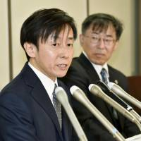 Cybozu President Yoshihisa Aono addresses the media Jan. 9 in Tokyo after filing a lawsuit against the government seeking the right to use his premarital name. Aono took his wife's surname upon marriage. | KYODO