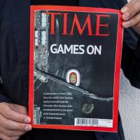 Fake news: The time capsule from the future that turned up at Florian Busch Architects' Tokyo office included photos and models of the Tokyo 2020 Floating Stadium, as well as newspapers and magazines lauding the waterborne structure. | FLORIAN BUSCH ARCHITECTS