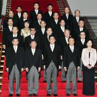 On the red carpet: Members of Prime Minister Shinzo Abe's Cabinet pose for a photograph in Tokyo in November 2017. | KYODO