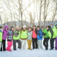 Ready for snow: Jeff Jensen (fourth from right) and Kozue Oka (sixth from right) with Mira no Mori bilingual camp staff on the first day of the 2018 Winter Camp.  COURTESY OF MIRAI NO MORI, CREDIT: LIFE14 PHOTOGRAPHY