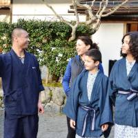 A monk at Ekoin attends to foreign visitors. | KYODO