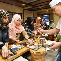 Halal special: Muslim women learn how to make halal sushi at a tasting event held at Tadao Obayashi's sushi restaurant in Fukuoka. | KYODO