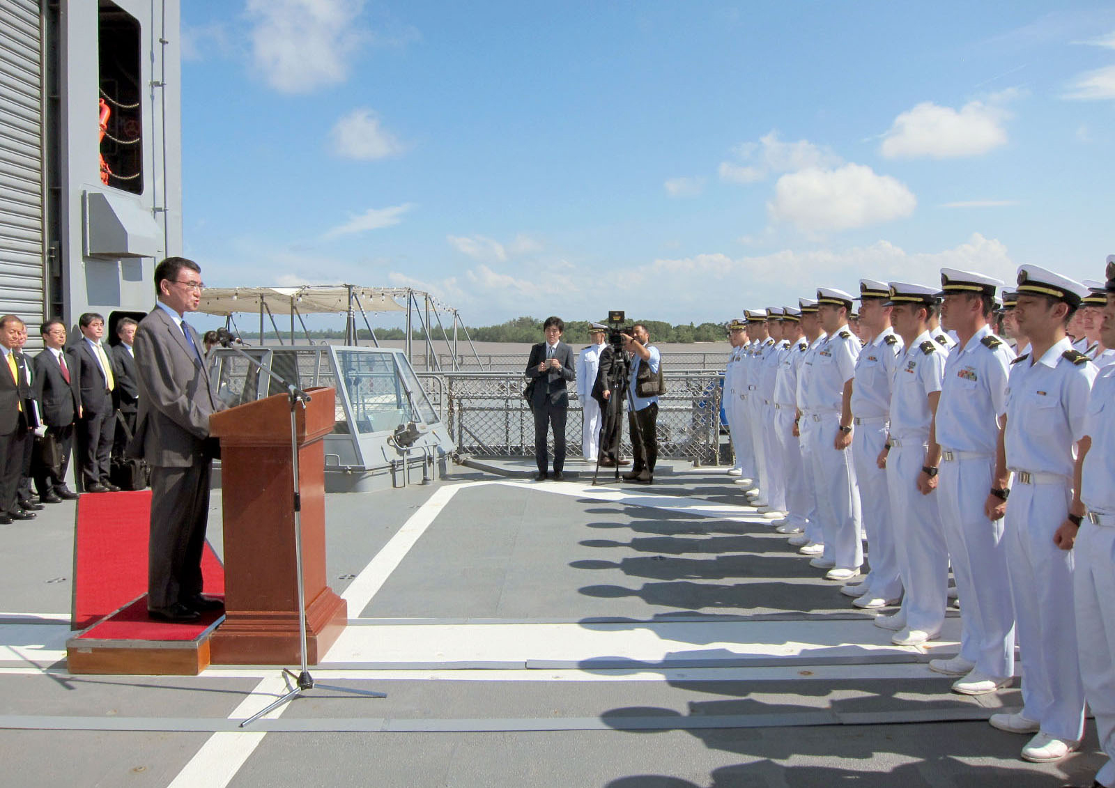 Foreign Minister Taro Kono addresses the crew of the Maritime Self-Defense Force destroyer Yamagiri in Singapore on Sunday. Kono emphasized Japan's interest in ensuring the South China Sea remains 'free and open.' | KYODO