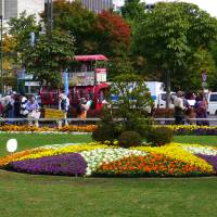 Families enjoy the sights and sounds of Odori Park in downtown Sapporo.   MELISSA DEVAUGHN