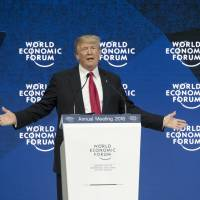 U.S. President Donald Trump speaks Jan. 26 at the World Economic Forum in Davos, Switzerland. He stated that the U.S. would consider negotiating trade deals with its onetime TPP partners 'either individually, or perhaps as a group' — but only 'if it is in the interests of all.' | BLOOMBERG