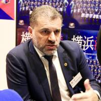 Yokohama F. Marinos manager Ange Postecoglou speaks at an event ahead of the start of the new J. League season this weekend. | KAZ NAGATSUKA