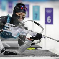 Mikito Tachizaki gets up after shooting during the men's 10-km biathlon sprint at the Pyeongchang Olympics on Sunday. | AP