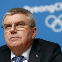 International Olympic Committee president Thomas Bach listen to a question at a news conference on Sunday in Pyeongchang, South Korea. | AP
