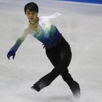 Yuzuru Hanyu, seen competing at the World Team Trophy in April 2017, is the defending men's Olympic champion. | AP