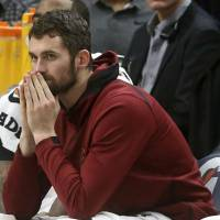 Cleveland's Kevin Love will be sidelined for two months, but will not need surgery, after breaking a metacarpal in his left hand in a loss to the Detroit on Tuesday night. | AP