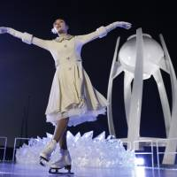 Yuna Kim, the 2010 Olympic women's figure skating champion, performs before lighting the Olympic flame during the opening ceremony of the 2018 Pyeongchang Games on Friday. | AP