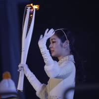 Yuna Kim prepares to light the Olympic cauldron during the opening ceremony at Pyeongchang Olympic Stadium.