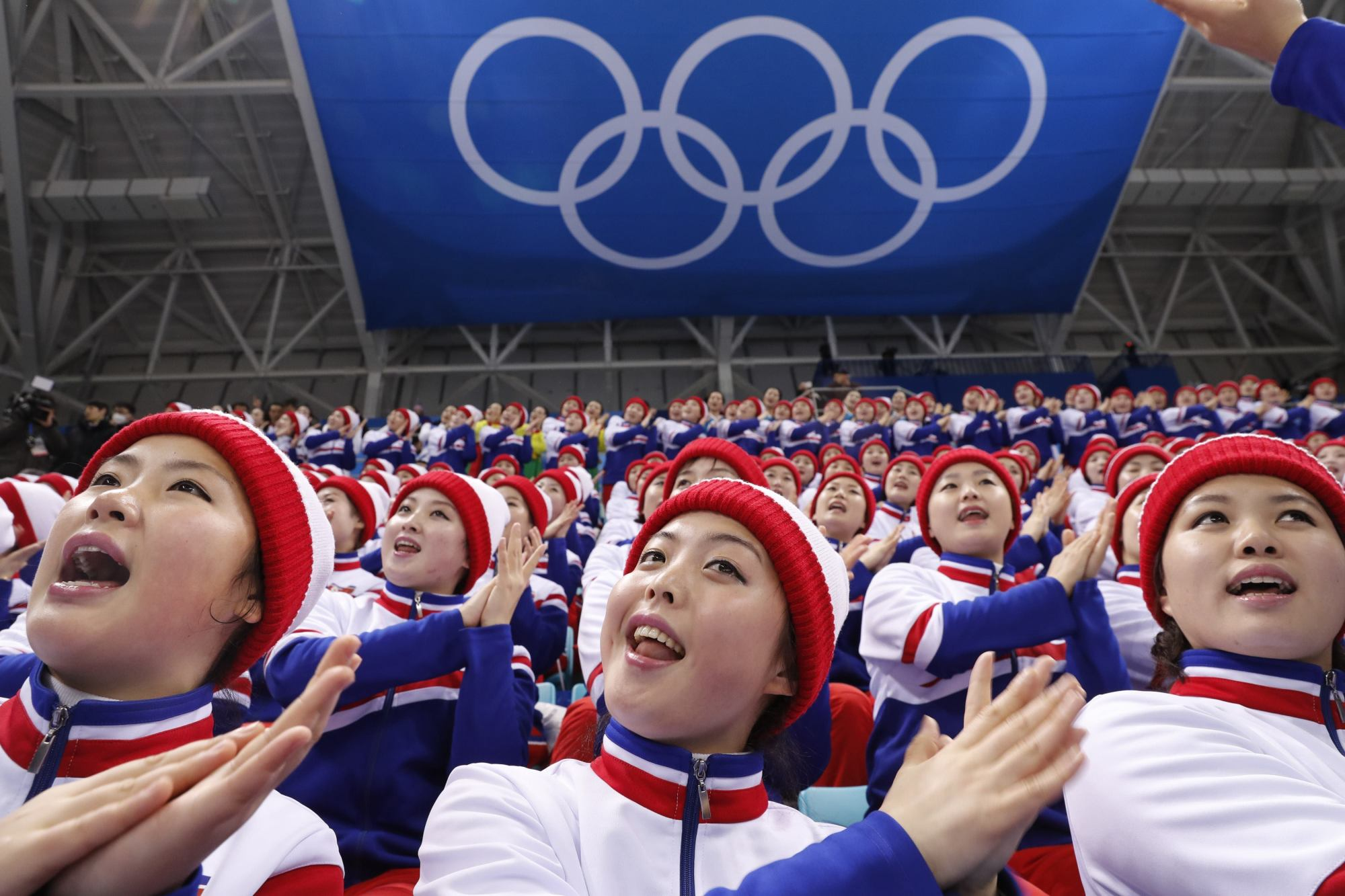 North Korean cheerleaders attend the Czech Republic-South Korea men's ice hockey match in Gangneung, South Korea, on Thursday. | REUTERS
