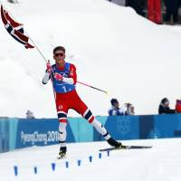 Norway's Johannes Hoesflot Klaebo celebrates his triumph in the men's 4x10-km relay on Sunday at Alpensia Cross-Country Skiing Centre. | REUTERS