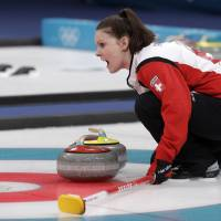 Like clockwork, Swiss pair delivers perfection on ice
