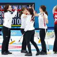 The Japanese team reacts after their match against Switzerland on Wednesday in Gangneung, South Korea | KYODO