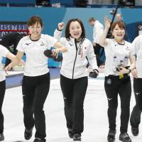 The Japan women's curling squad is delighted by the euphoria of collecting the bronze medal on Saturday night. Japan defeated Great Britain in Gangneung, South Korea. | KYODO