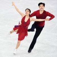 Japanese-Americans Maia Shibutani and Alex Shibutani perform their free dance at Gangneung Ice Arena on Tuesday. The siblings earned the bronze medal. | AFP-JIJI