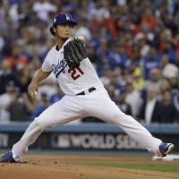 Yu Darvish pitches for the Dodgers during Game 7 of the World Series in Los Angeles on Nov. 1, 2017. Darvish reportedly agreed to a six-year deal with the Cubs on Saturday. | AP
