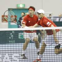 Japan's Ben McLachlan (right) and Yasutaka Uchiyama face Italy's Simone Bolelli and Fabio Fognini in a  Davis Cup World Group first-round tie on Saturday in Morioka, Iwate Prefecture. The Italians won 7-5, 6-7 (4-7), 7-6 (7-3), 7-5. | KYODO