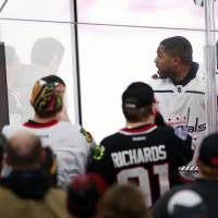 Washington Capitals right wing Devante Smith-Pelly (25) argues with Chicago Blackhawks fans from the penalty box during the third period of an NHL hockey game Saturday in Chicago. The Blackhawks won 7-1 and four fans were ejected. | AP