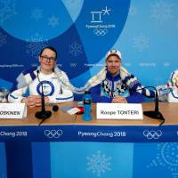 Members of the Finland Olympic team attend a Wednesday news conference regarding their knitting project in Pyeongchang, South Korea. | REUTERS