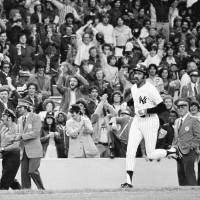 Former  New York Yankees outfielder/designated hitter Oscar Gamble, heading home after hitting a ninth-inning home run against the Oakland Athletics on June 6, 1976,  played for seven MLB teams during his career. | AP