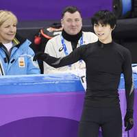Yuzuru Hanyu practices as his coach Brian Orser (rear, right) watches on Tuesday at Gangneung Ice Arena. | KYODO