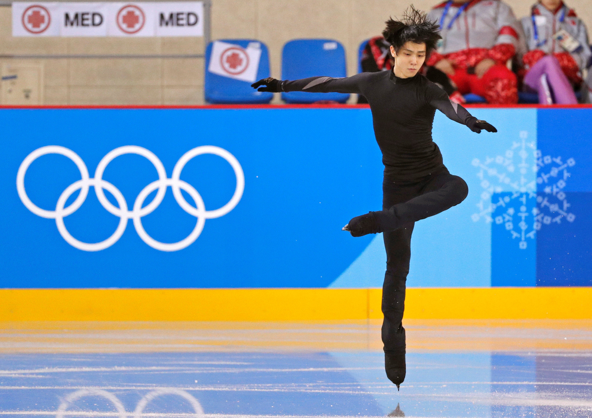 Reigning champion Yuzuru Hanyu practices for the Olympic men's figure skating competition at Gangneung Ice Arena on Monday. The competition is scheduled to begin Friday. | REUTERS