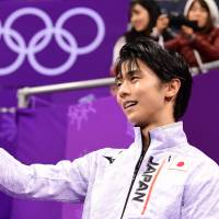 Yuzuru Hanyu reacts after his free skate in the men's figure skating competition at the Pyeongchang Olympics on Saturday. | AFP-JIJI
