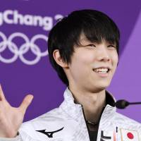 Yuzuru Hanyu speaks during a news conference on Tuesday morning in Gangneung, South Korea. | KYODO