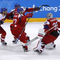 Czech Republic goalie Pavel Francouz celebrates with teammates after their 3-2 shootout victory over the United States in the Olympic hockey men's quarterfinals at Gangneung Hockey Centre on Wednesday. | REUTERS