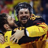 Germany's Matthias Plachta (left) and Yannic Seidenberg celebrate after beating Canada in the semifinals of the Pyeongchang Olympics on Friday at Gangneung Hockey Centre.   REUTERS