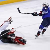 Jocelyne Lamoureux-Davidson of the United States scores the game-wining goal in the shootout against Canada on Thursday. | REUTERS