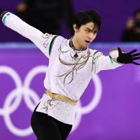 Two-time Olympic champion Yuzuru Hanyu's intense mental focus, amazing physical gifts and huge popularity resonate with skating observers around the world. | AFP-JIJI