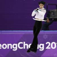 Yuzuru Hanyu competes in the men's Olympic figure skating competition on Saturday. | REUTERS