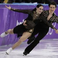 Canada's Tessa Virtue and Scott Moir perform their short program during the Olympic ice dance competition on Monday in Gangneung, South Korea. | AP