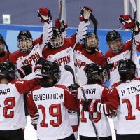 Smile Japan celebrates after defeating Sweden in the Olympic women's hockey tournament on Sunday in Gangneung, South Korea. | REUTERS