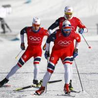 Members of Norway's cross-country skiing team train on Wednesday. | REUTERS