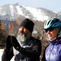 Swiss couple cycle 17,000 kilometers to watch son compete in freestyle skiing